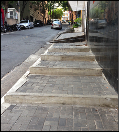 One of the better-paved sidewalks, but still inaccessible for many. (Credit: Anthony Scott)