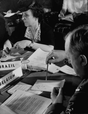 San Francisco Conference Brazil's Feminist Bertha Lutz (C) listening to proceedings of a sub-comm. meeting. with others; Conf. to adopt UN Charter.